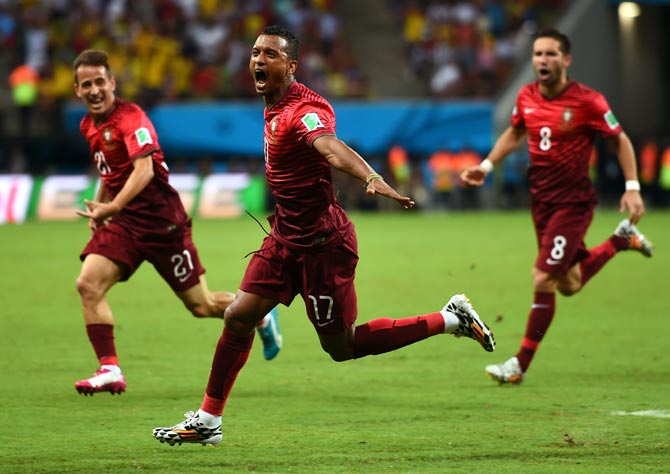 Nani of Portugal (centre) celebrates scoring his team's first goal against USA
