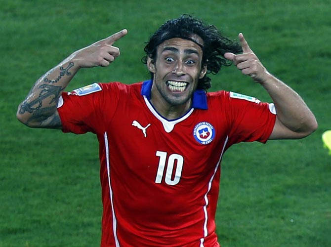 Chile's Jorge Valdivia celebrates scoring against Australia.