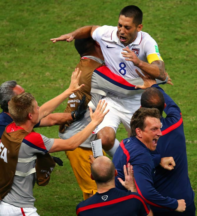 Clint Dempsey of the United States celebrates with teammates after scoring his team's second goal against Portugal.