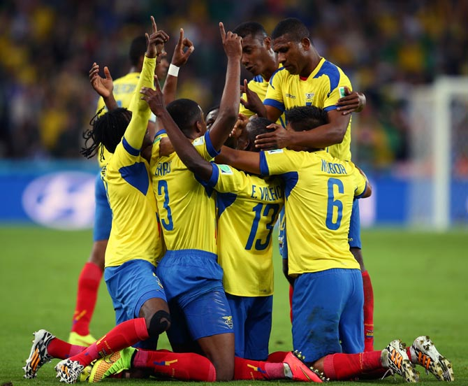 Ecuador's players celebrate after Enner Valencia scores the second goal against Honduras.