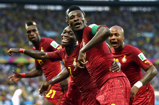 Asamoah Gyan (centre) of Ghana celebrates scoring his team's second goal against Germany.