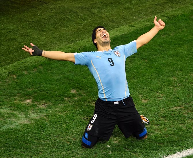 Luis Suarez of Uruguay celebrates after scoring his team's second goal against England