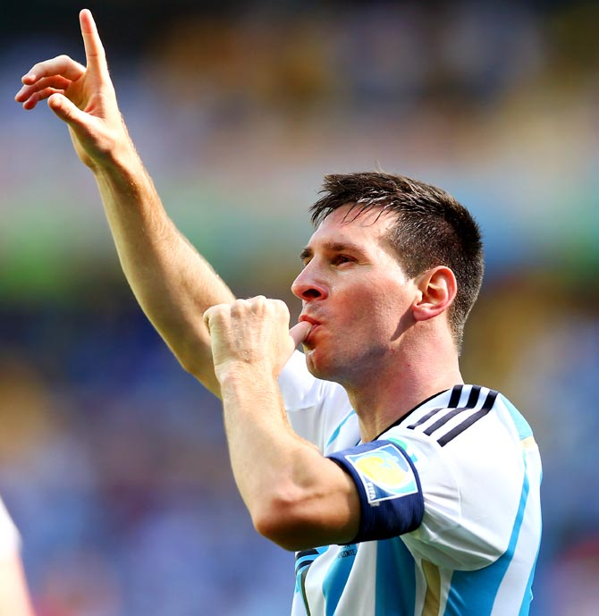 Lionel Messi of Argentina celebrates after scoring a goal against Iran.