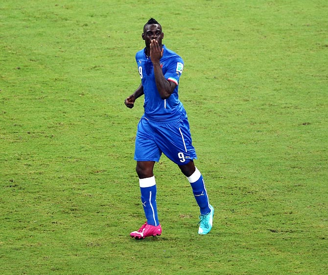 Mario Balotelli celebrates after scoring Italy's second goal against England