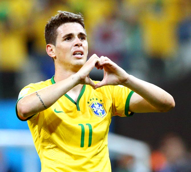 Oscar of Brazil celebrates his goal in the second half against Croatia