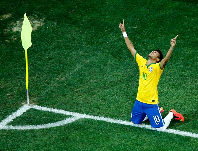 Brazil striker Neymar celebrates after scoring his second goal against Croatia.