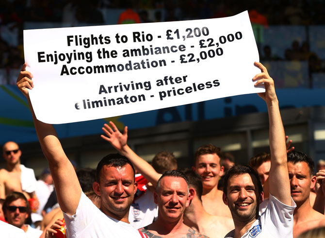 England fans hold up a sign during their match against Costa Rica at Belo Horizonte