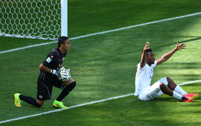 Daniel Sturridge of England reacts after a challenge as goalkeeper Keylor Navas of Costa Rica looks on