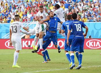 Diego Godin of Uruguay goes up for a header and scores against Italy.