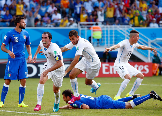 Diego Godin of Uruguay scores his team's first goal past goalkeeper Gianluigi Buffon of Italy