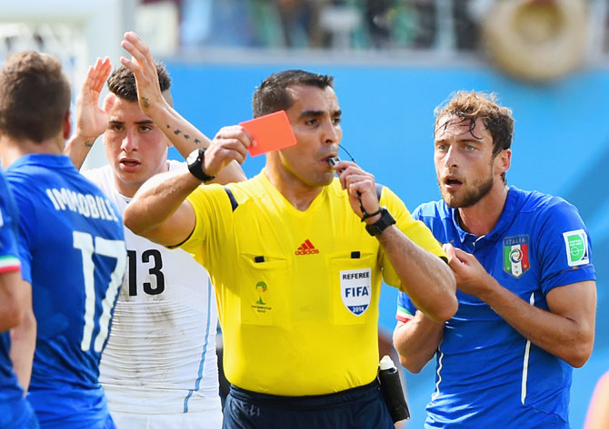 Referee Marco Rodriguez shows a red card to Claudio Marchisio of Italy