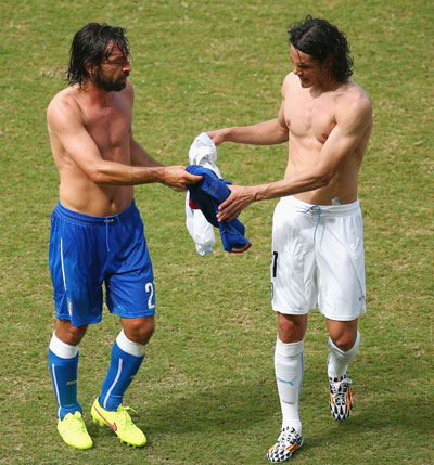 Andrea Pirlo of Italy and Edinson Cavani of Uruguay exchange jerseys