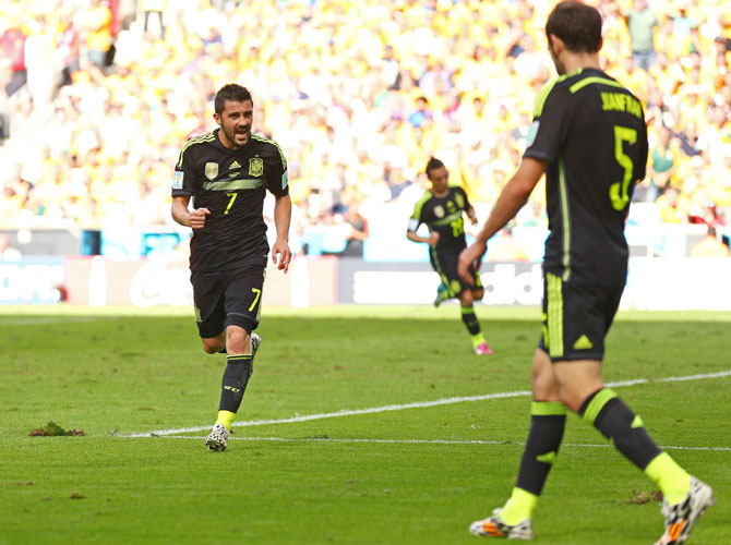 David Villa of Spain (left) celebrates scoring his team's first goal with Juanfran