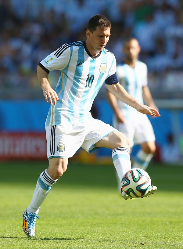 Lionel Messi controls the ball during the match against Iran