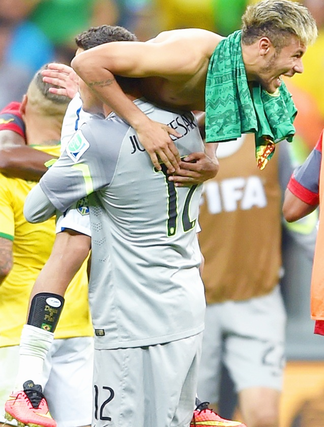Goalkeeper Julio Cesar and Neymar of Brazil celebrate after defeating Cameroon