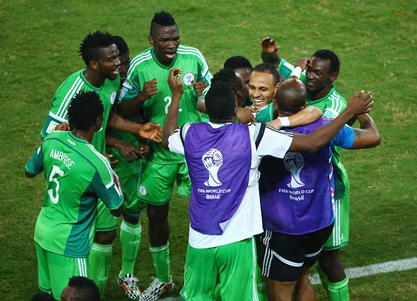 Peter Odemwingie of Nigeria (centre) celebrates scoring his team's first goal with teammates against Bosnia-Herzegovina