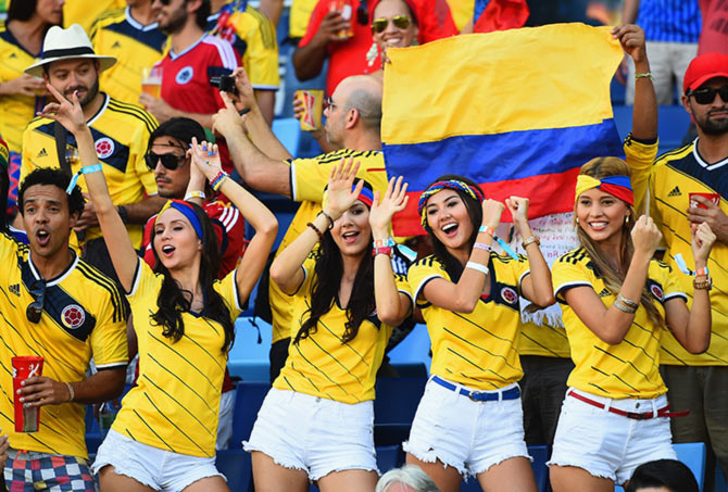 Colombia fans cheer during the 2014 FIFA World Cup Group C match between Japan and Colombia in Cuiaba.