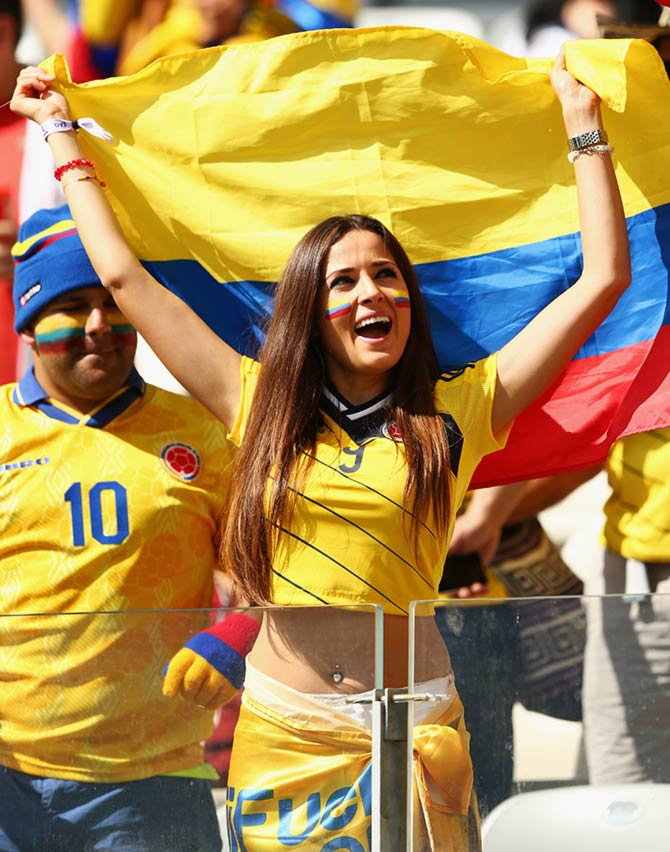 A Colombia fan cheers during the World Cup match against Japan in Cuiaba.