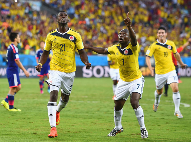 Jackson Martinez of Colombia (left) celebrates scoring his team's second goal