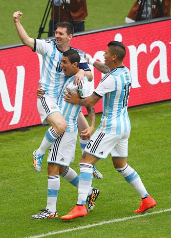 Lionel Messi (left) celebrates with teammates Angel di Maria (centre) and Marcos Rojo after scoring Argentina's first goal against Nigeria.