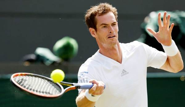Andy Murray of Britain hits a return to Blaz Rola of Slovenia during their men's singles tennis match at the Wimbledon Tennis Championships