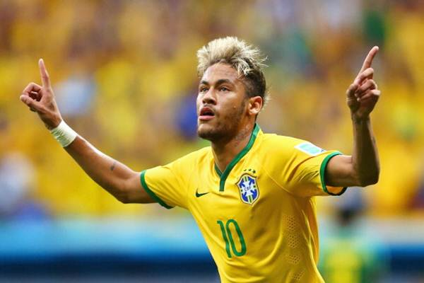 Brazil's Neymar celebrates scoring against Cameroon