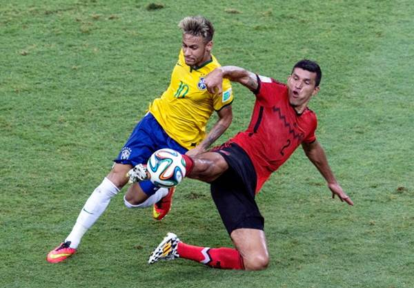 Neymar fights off Francisco Javier Rodriguez of Mexico during the Group A World Cup match