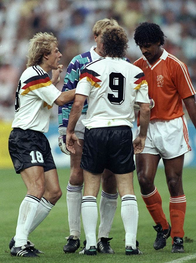 Jurgen Klinsmann (left) and Rudi Voller (centre) both of West Germany and Frank Rijkaard (right) of Holland in discussion with the referee