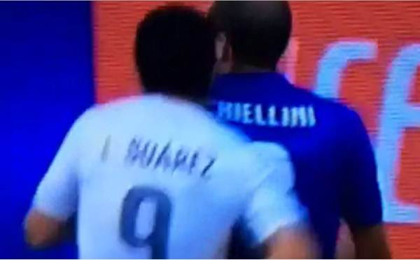 Video grab of Uruguay's Luis Suarez biting Italy's Giorgio Chiellini from behind during the World Cup Group D match