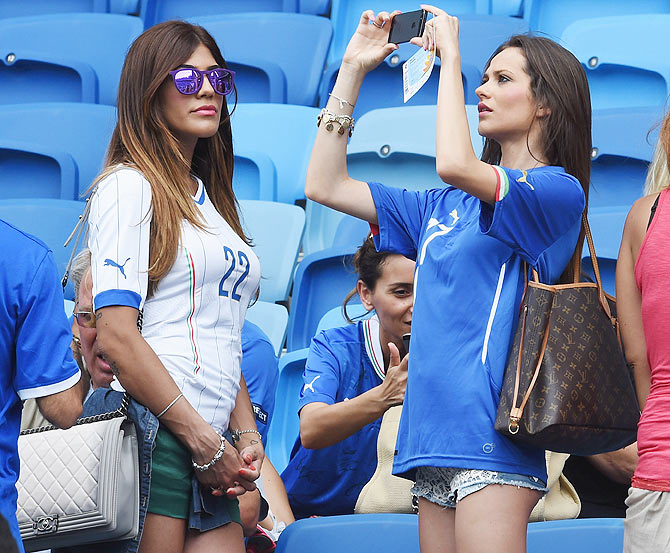 Jenny Darone, wife of Lorenzo Insigne of Italy and Ciro Immobile of Italy's wife Jessica arrive at the stadium between Italy and Uruguay at Estadio das Dunas in Natal on Tuesday