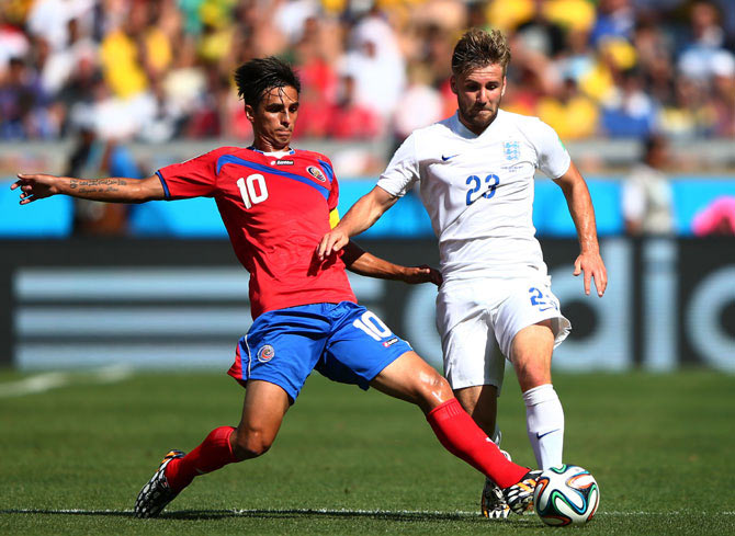 Luke Shaw of England is challenged by Bryan Ruiz of Costa Rica
