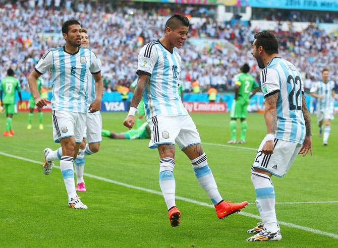 Marcos Rojo of Argentina (center) celebrates scoring his team's third goal with Ezequiel Garay (left) and Ezequiel Lavezzi