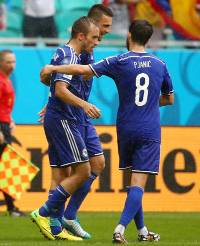Avdija Vrsajevic of Bosnia and Herzegovina (center) celebrates with his teammates scoring his team's third goal