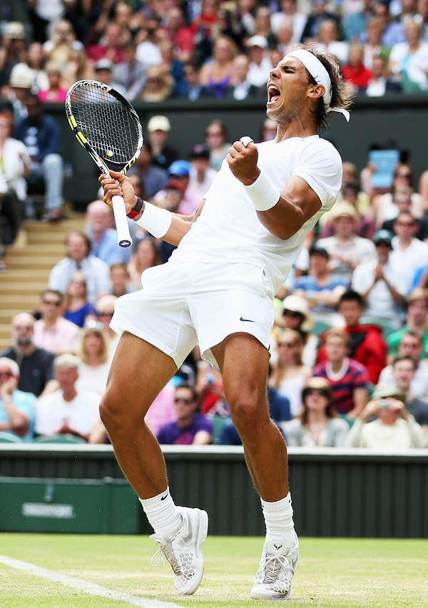 Rafael Nadal celebrates after beating Lukas Rosol of the Czech Republic