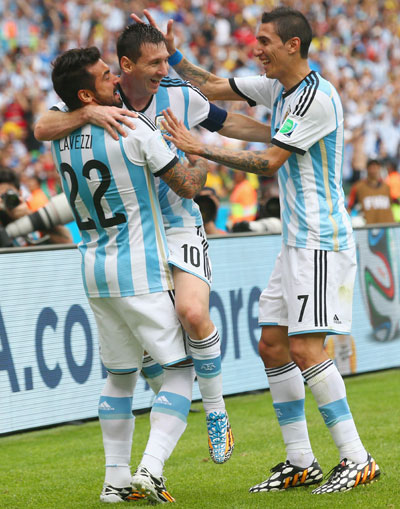 Lionel Messi of Argentina celebrates scoring his team's second goal and his   second of the game with Ezequiel Lavezzi (left) and Angel di Maria (right)