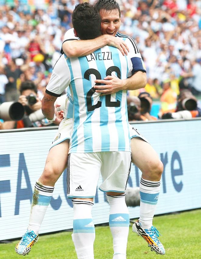 Lionel Messi of Argentina celebrates scoring his team's second goalwith Ezequiel Lavezzi