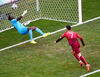 Ghana goalkeeper Fatawu Dauda makes a save off a header at goal by Cristiano Ronaldo of Portugal