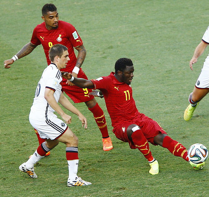 Germany's Philipp Lahm (left) fights for the ball with Ghana's Sulley Muntari (right) and Kevin-Prince Boetang