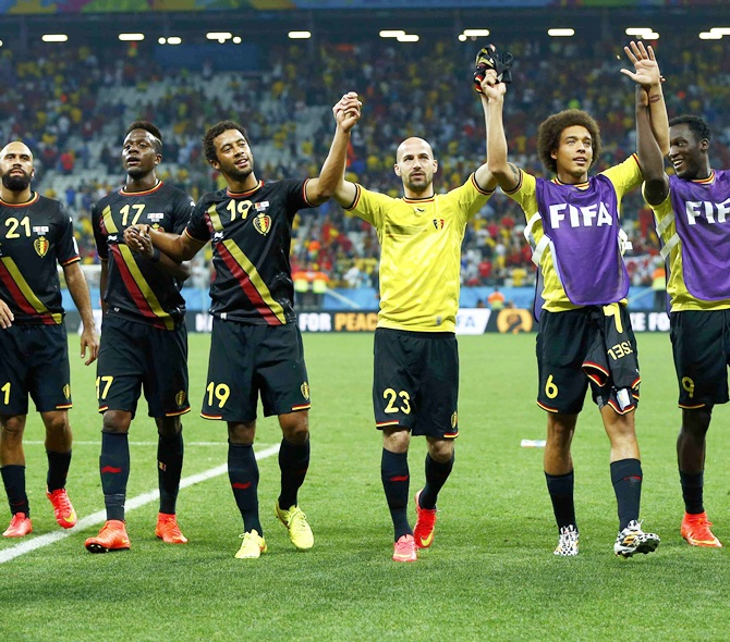 The Belgium team celebrate after their 2014 World Cup Group H soccer match against South Korea at the Corinthians arena in Sao Paulo