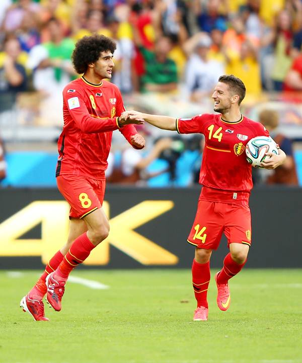 Belgium's goal-scorers Marouane Fellaini (left) and Dries Mertens celebrate after the victory over Algeria in Tuesday's World Cup match