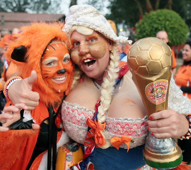 Dutch fans head for the Arena Corinthians soccer stadium
