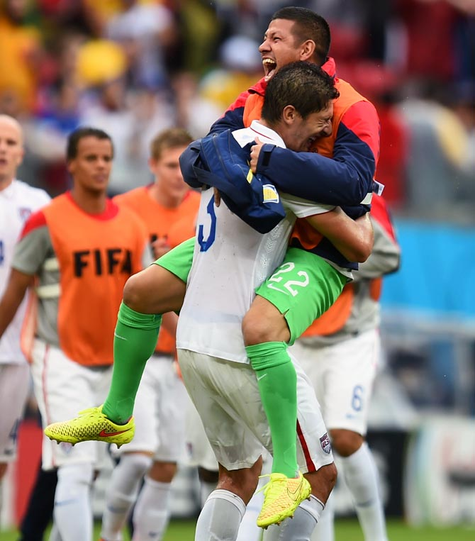 Omar Gonzalez (L) and Nick Rimando of the United States celebrate after the match