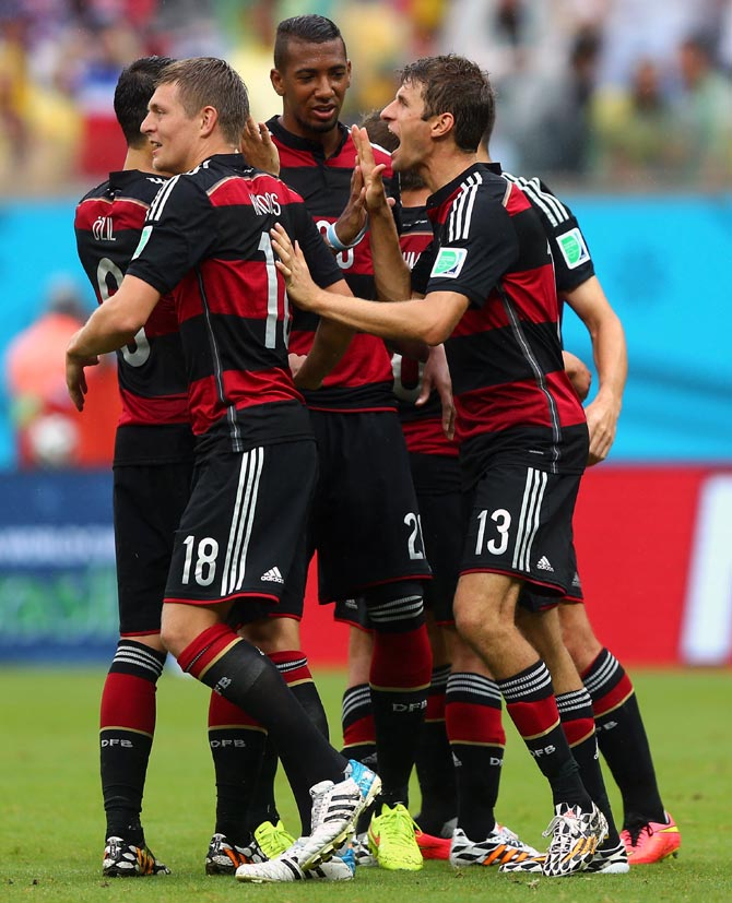 Germany's players celebrate after Thomas Mueller (right) scored the goal.