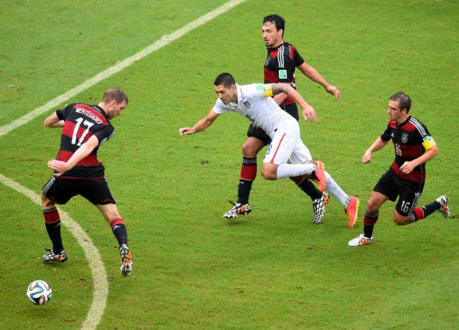Clint Dempsey (centre) of the US competes tries to get the ball past the German defenders