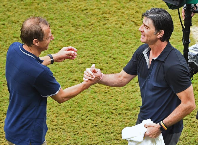 Head coaches Jurgen Klinsmann of the United States (left) and Joachim Loew of Germany shake hands after the match