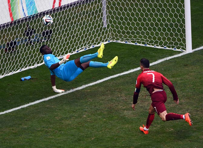 Ghana goalkeeper Fatawu Dauda (left) saves the header from Cristiano Ronaldo