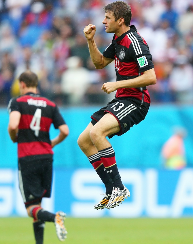 Thomas Mueller celebrates scoring for Germany against the United States