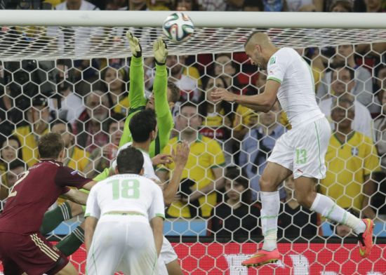 Algeria's Islam Slimani (right) heads the ball to score against Russia