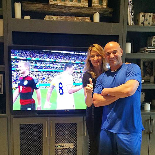Steffi Graf and husband Andre Agassi look satisfied after the U.S.-Germany match on Thursday