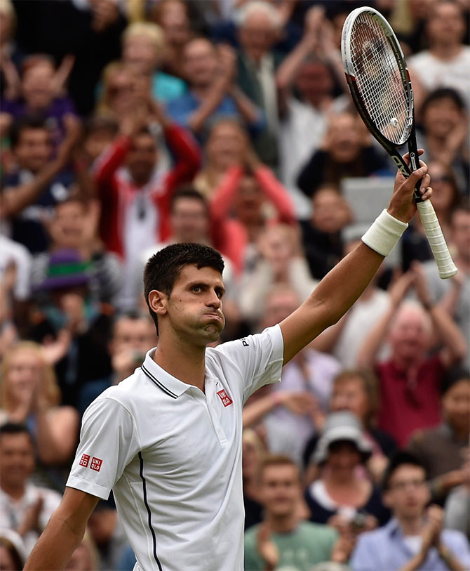 Novak Djokovic of Serbia reacts after defeating Radek Stepanek of the Czech Republic